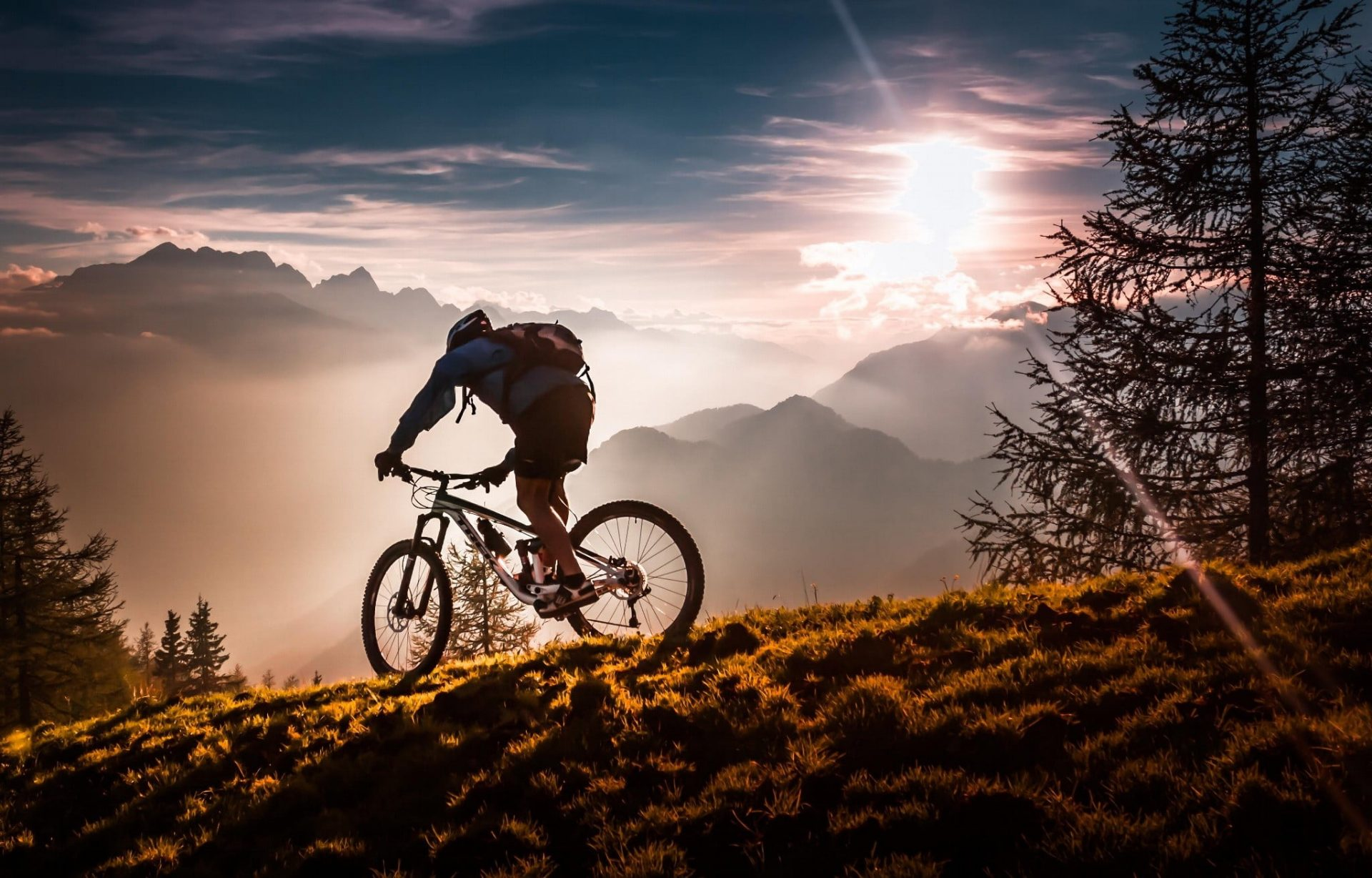 a man ride the bike on the mountain